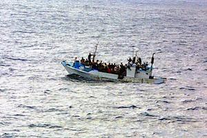 Picture: Refugees on a boat courtesy Wikipedia.