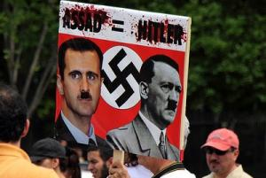 Picture: An anti-Bashar al Assad poster at a Free Syria rally in front of the White House courtesy Mr. T in DC/Flickr.