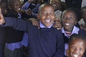 Picture: Children from Lukhanyo Primary School, Zwelihle Township, Hermanus courtesy Godot13/Wikimedia Commons.