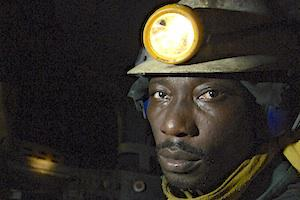 Picture: A worker in an Anglo Ashanti gold mine courtesy Jonathan Ernst/World Bank
