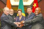 Picture: BRICS heads of state and government hold hands ahead of the 2014 G-20 summit in Brisbane, Australia, courtesy Roberto Stuckert Filho/Agencia Brasil