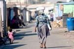 Picture: Woman walking in Langa township courtesy WBUR Boston