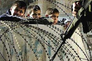 Picture: Boys in Gaza fenced in behind a barricade courtesy Dale Spencer/flickr