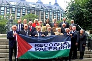 Picture: British MPs supporting the recognition of the State of Palestine pose with a Palestinian flag courtesy Press TV