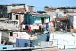 Picture credit: A South African shack settlement in an urban area courtesy jason&molly/Flickr.