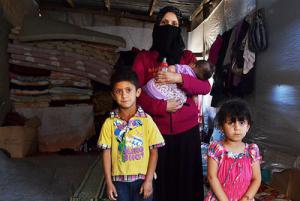 Picture: New arrivals in Lebanon last year. Refugee Khatar with three of her six children in a cowshed on a farm in the Bekaa valley (CAFOD Photo Library/flickr)