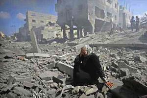 Picture: A woman is overcome and weeps at the destruction of her neighbourhood in Gaza courtesy Cintayati